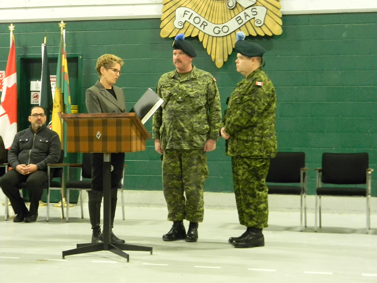 Premier of Ontario Kathleen Wynne presents a scroll commemorating 100 years of the Irish Regiment of Canada to Major Ken McClure and Honourary Lieutenant-Colonel Kevin McCormick.