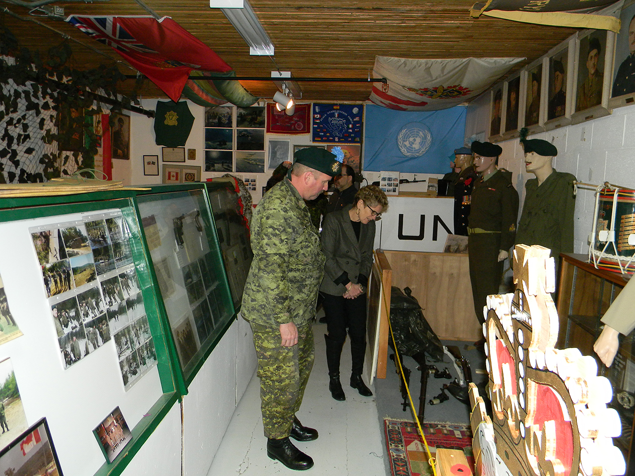 Major Ken McClure guides Premier of Ontario Kathleen Wynne around the 2nd Battalion Irish Regiment of Canada's Regimental Museum. 