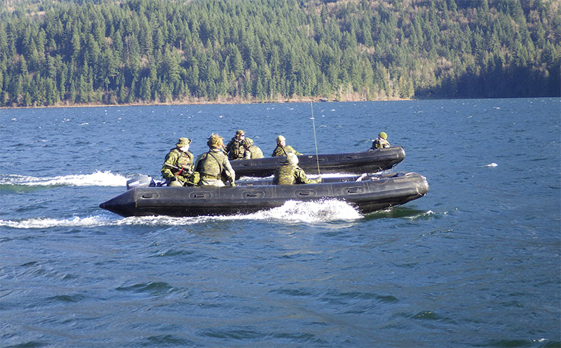 An assault boat parallels the vehicle raft