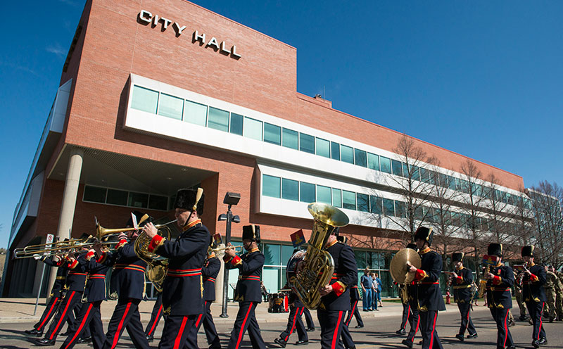 The parade marches past City Hall in Medicine Hat.  Photo:  Corporal James McAllister (RLC)
