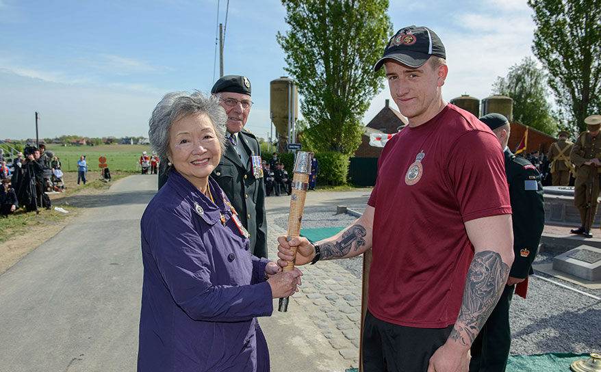 The Right Honourable Adrienne Clarkson, Colonel-in-Chief, Princess Patricia's Canadian Light Infantry (PPCLI) hands over The Memorial Baton to Private Jake Dow, 2 PPCLI, during the Voormezele Service in Belgium, on May 8th, 2015.  Photo: MCpl Louis Brunet, Canadian Army Public Affairs, 3rd Can Div HQ