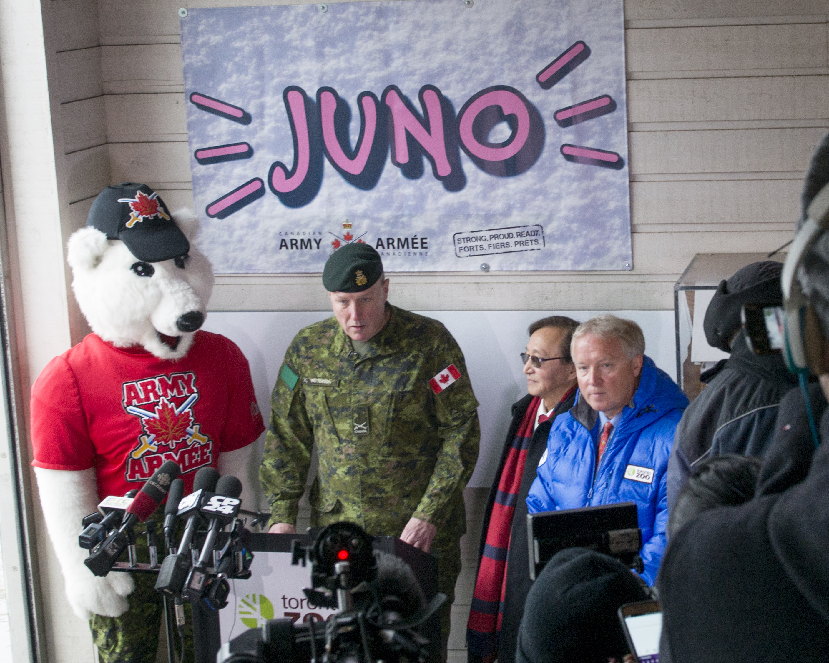 Brigadier-General David Patterson, Deputy Commander of the 4th Canadian Division, speaks on behalf of the 4th Canadian Division Commander during the welcoming of Private Juno, the polar bear cub, at Toronto Zoo on February 25, 2016. (Left to right: Juno the Army Mascot, BGen Patterson, Raymond Cho, Chair, Toronto Zoo and John Tracogna, CEO, Toronto Zoo.). Photo by: MCpl Precious Carandang, 4th Canadian Division Public Affairs 2016 DND-MDN Canada.