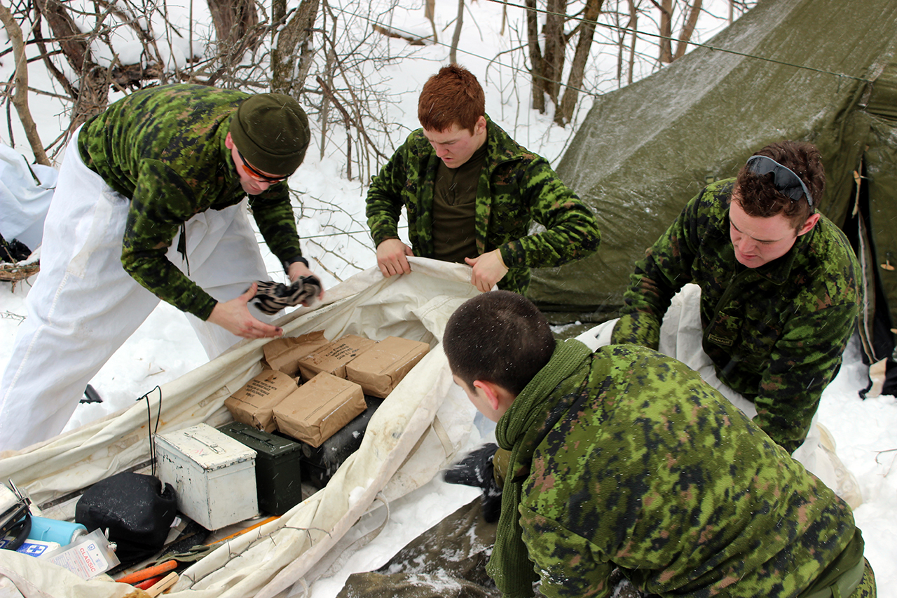 A section from The Ontario Regiment organizes their supplies in their toboggan during Exercise ARCTIC LYNX, January 22 to 24, 2016.