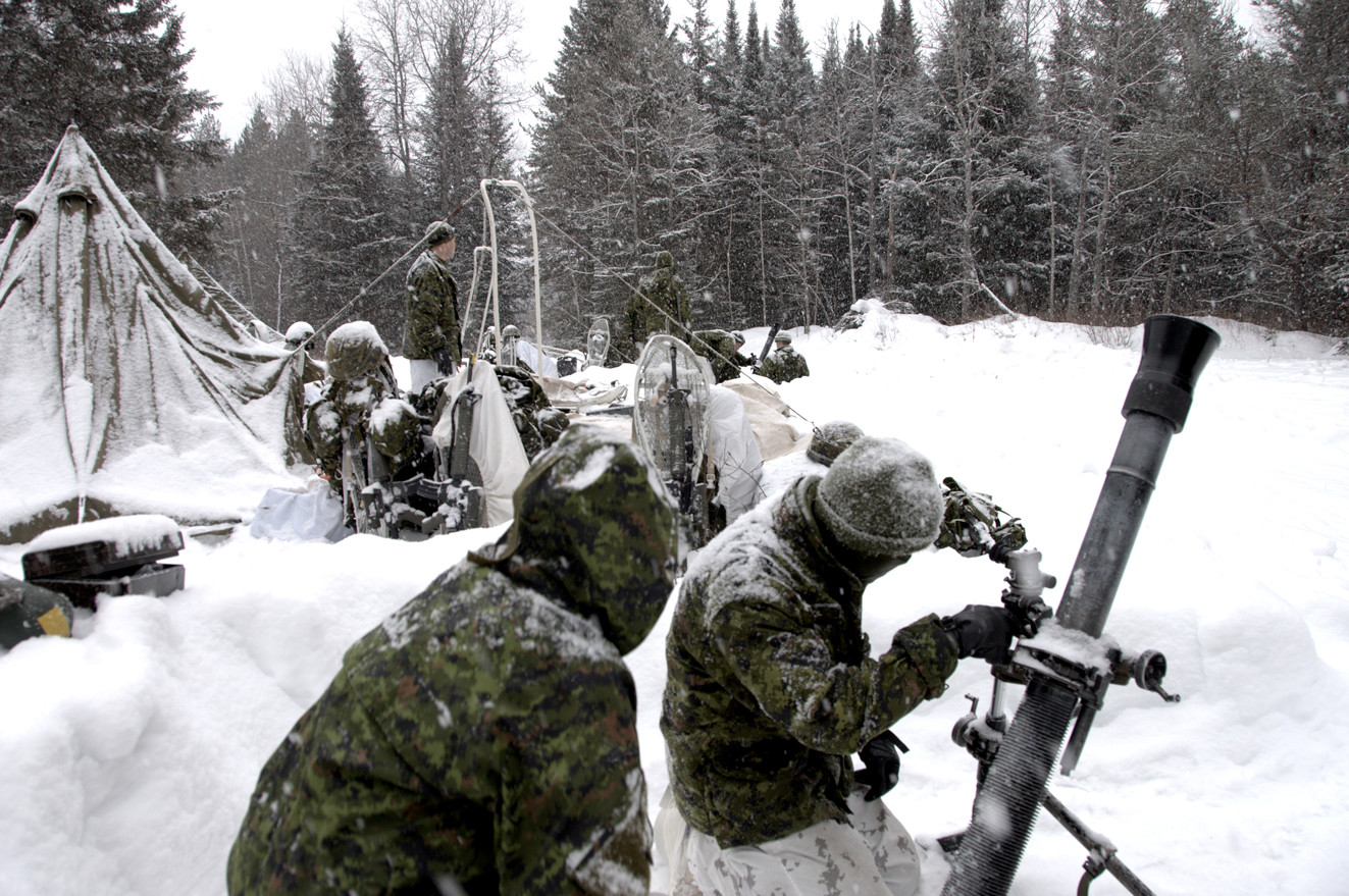 In front of their tent lines members of 49th Field Regiment adjust their 81 mm mortars during a fire mission drill while on Exercise FROZEN PATRIOT, February 28, 2016.