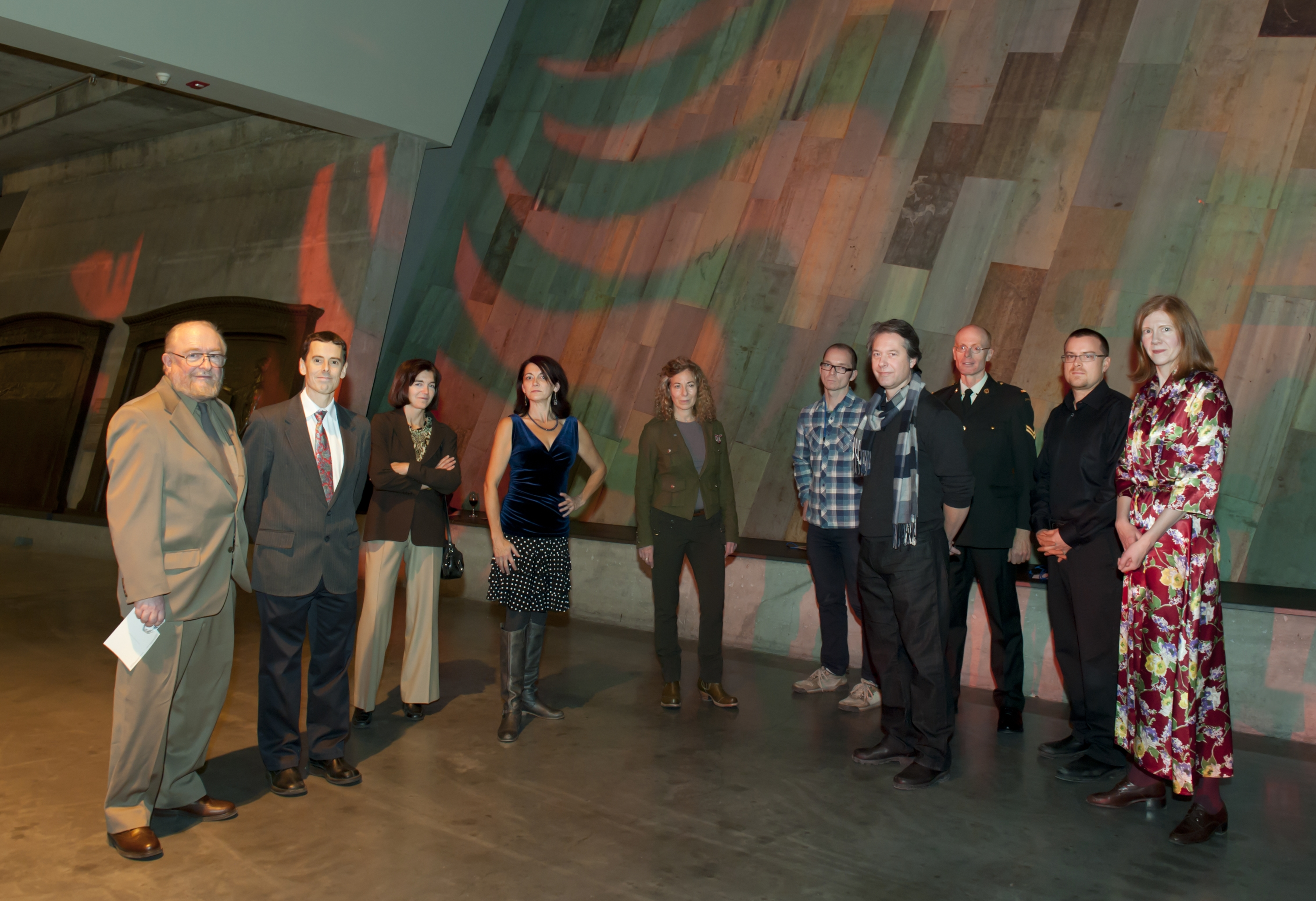 At the Artists at Brush with War exhibit at the Canadian War Museum on December 9, 2010. From left to right, Bill MacDonell, John McFarlane, Karole Marois, Suzanne Steele, Gertrude Kearns, Scott Waters, Alex Meyboom, David Collier, Andrew Wright and Karen Bailey. Photo supplied by: John McFarlane