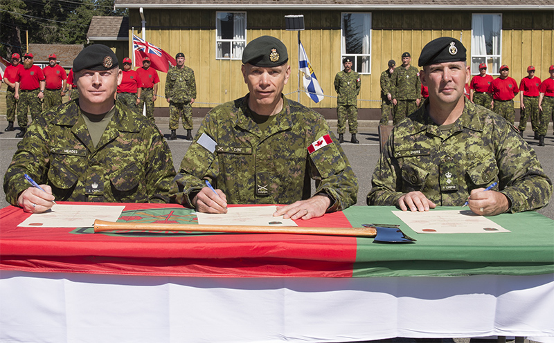 LCol Russ Meades, BGen Wayne Eyre, and LCol Tim Byers sign Change of Command certificates
