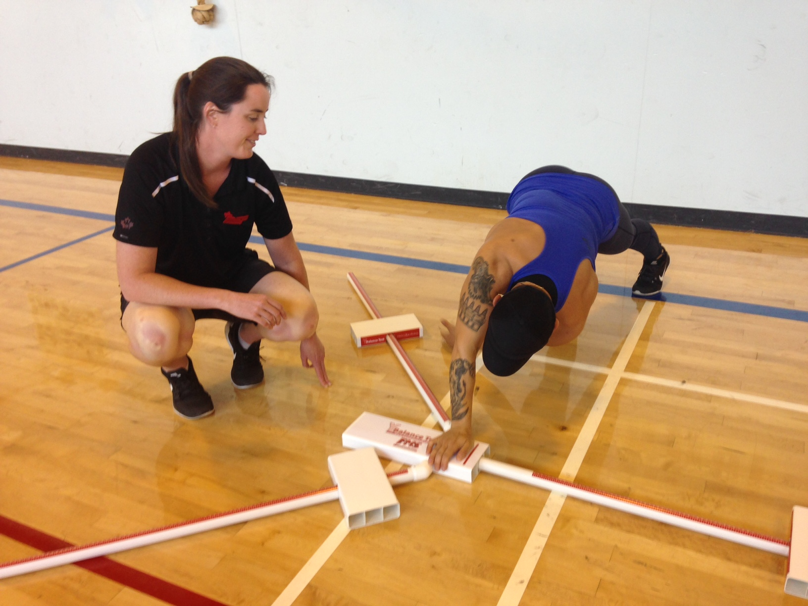 Lyndal Greig (left), Regional Adaptive Fitness Specialist for the Pacific Region, works with a Canadian Armed Forces member on July 11, 2016. She welcomes a new fitness program being developed by a Canadian Army member to identify troops prone to injuries before they happen. 