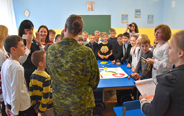 A member of Joint Task Force – Ukraine on Op UNIFIER speaks with teachers and students during a visit in honour of Ukraine's Defenders Day to Secondary School #98 in Lviv, Ukraine, on October 13, 2016. 