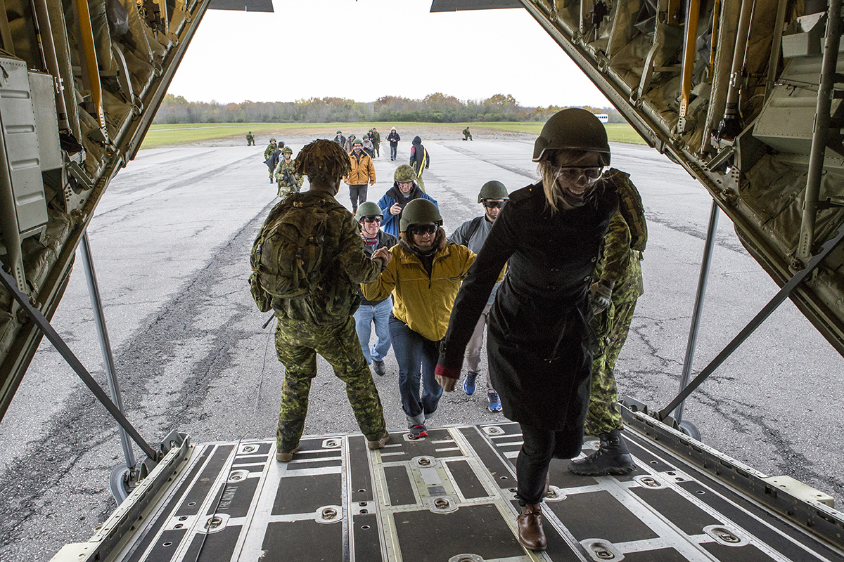 Members of the Queens own Rifles and 436 Squadron assist participants from the Executrek Program board a CC-130J transport plane at the Drop Zone in Canadian Forces Base Trenton during Exercise QUICK RIG on October 29, 2016.