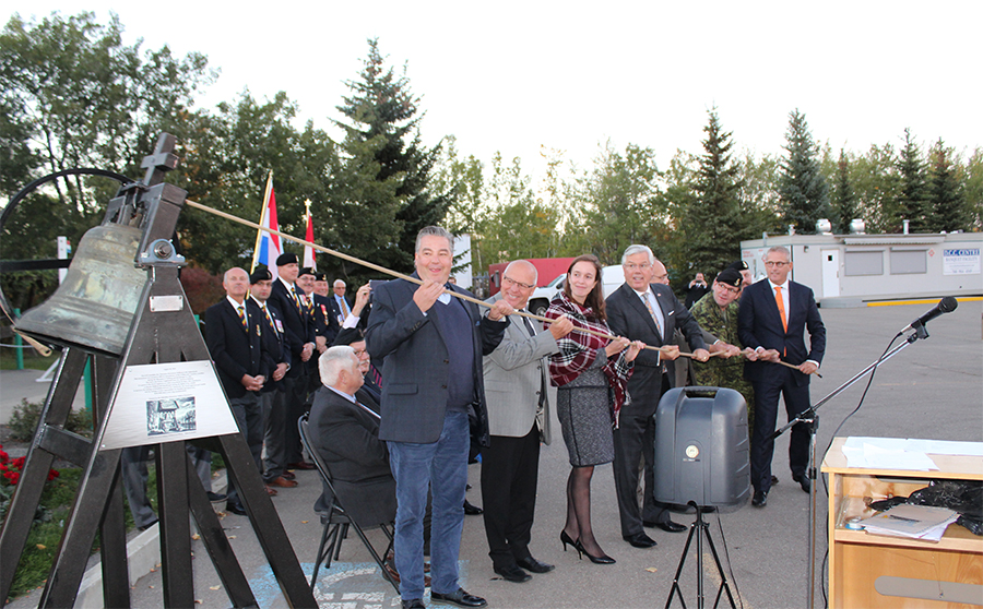 Mayor Ruud van den Belt, Mayor of Steenbergen, , LCol Troy Steele, Councillor Dave Loken, Angus Watt and representatives from Edmonton's Dutch Community, ring the replica of the Bell of the Liberation Monument presented to the SALH during a ceremony commemorating the Regiment's role in the Liberation of Holland at the Dutch Canadian Club on September 21, 2016