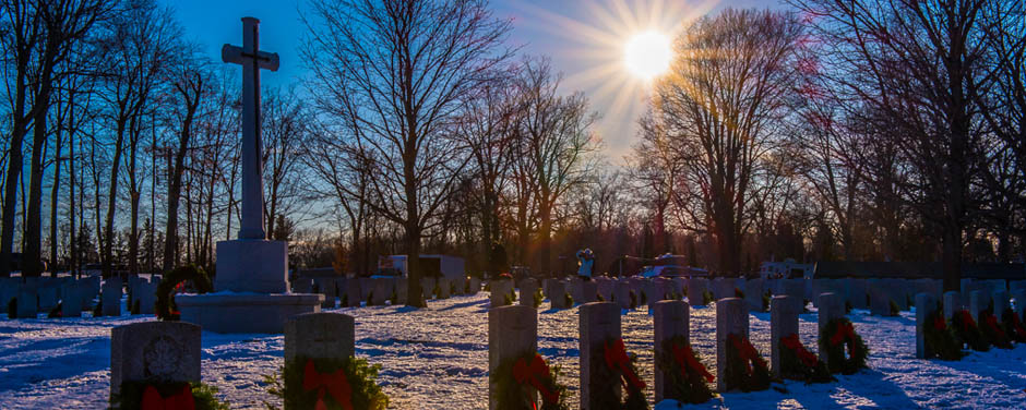 Slide - Wreaths on tombstones at sunset