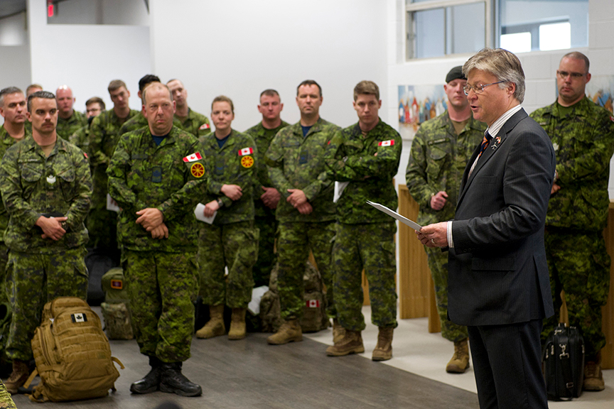 His Excellency Karlis Eihenbaums, Ambassador of Latvia to Canada, addresses 1 Canadian Mechanized Brigade Group soldiers before they deploy to Latvia on Operation REASSURANCE at Edmonton International Airport on June 9, 2017.