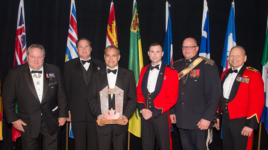 VIA Rail Canada Inc. receives the Canadian Forces Liaisons Council Award for most Supportive Employer in the Province of Quebec on May 25, 2017 during the event dinner at the Canadian War Museum in Ottawa, Ontario. From left to right: Mr. Jean Fournier, Mr. Scott Shepherd, Mr. Yves Desjardins-Siciliano (VIA Rail's President and Chief Executive Officer), Lieutenant Sebastien Langlais-Freeman, Chief Warrant Officer Charles O'Donnell and Major-General Paul Bury.