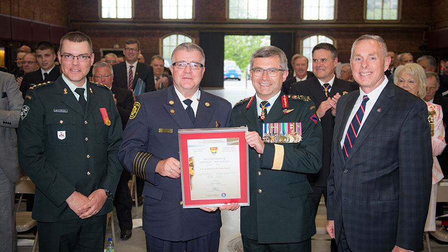 The Most Supportive in the Province of New Brunswick award is presented to the City of Saint John Fire Department at the Canadian Forces Liaison Council Awards Ceremony on May 25, 2017 at the Cartier Square Drill Hall in Ottawa, Ontario. From left to right: Captain David McCready, Fire Chief Kevin Clifford, Commander Canadian Army Lieutenant-General Paul Wynnyk and Mr. Peter McDougall.