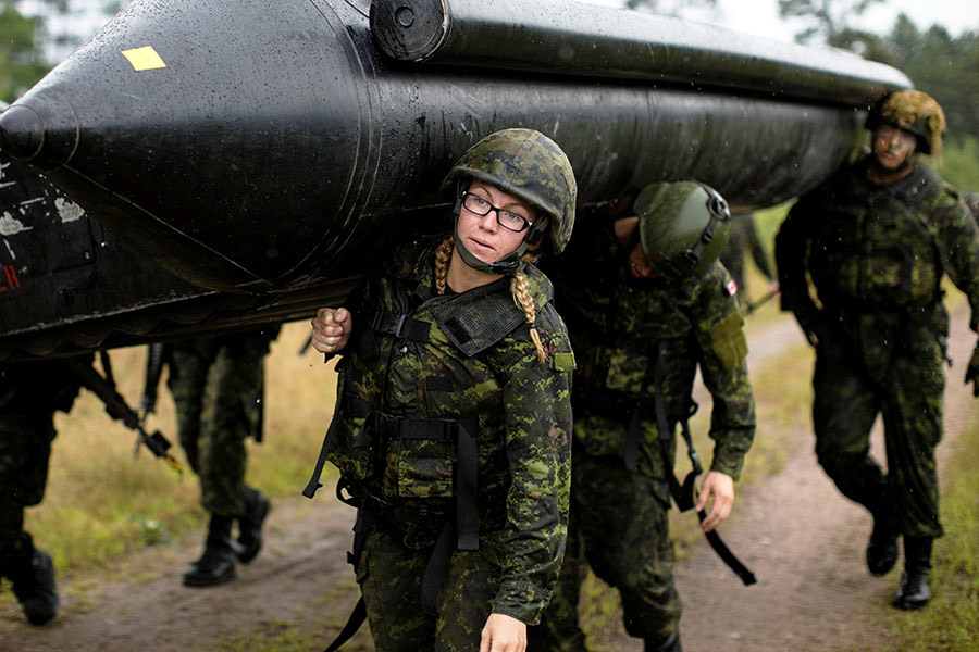 Bombardier Marie-Eve Cotton, from the 30th Field Artillery Regiment, helps carry an assault boat during Exercise STALWART GUARDIAN on August 20, 2015 at 4th Canadian Division Support Base Petawawa, Ontario. Photo: 32 Canadian Brigade Group Public Affairs. ©2015 DND/MDN Canada.