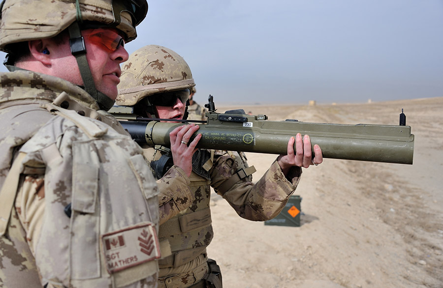 Sergeant Josh Mathers from 2nd Battalion, Princess Patricia's Canadian Light Infantry oversees Corporal Ashley Turner from 39 Signals Regiment as she fires the M72 light anti-tank weapon at the Kabul Military Training Centre range in Kabul, Afghanistan on November 4, 2013 during Operation ATTENTION.