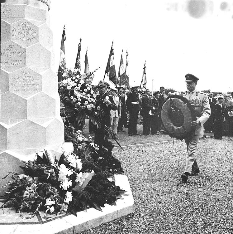 Major-General Roger Rowley places a wreath at the Dieppe War Memorial at Canada Square during a ceremony held on August 19, 1967. Honorary Colonel David Lloyd Hart, the Canadian Army's longest-serving officer, was awarded the Military Medal for bravery for his actions at Dieppe.