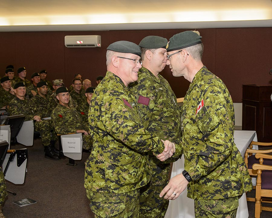 Brigadier-General Derek Macaulay shakes hands with Colonel Marc LaFortune, Commander of the Canadian Combat Support following the Transfer of Command Authority on October 4, 2017 at Korea Hall, Fort Frontenac, Kingston, Ontario. Photo: Steven McQuaid, CFB Kingston Base Photo ©2017 DND/MDN Canada.
