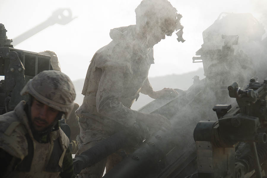 Gunners from the 5e Régiment d'artillerie légère du Canada (5 RALC), X Battery, reloading their 155mm M777 cannons to fire on enemy positions in the north of Kandahar Province, Afghanistan on November 29, 2007. 