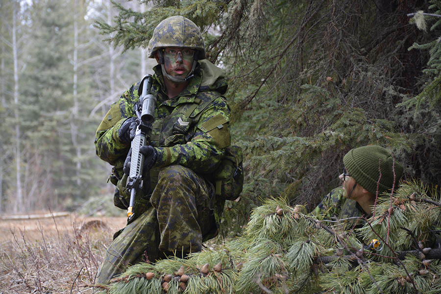 Corporal Andrew Noel, of 41 Service Battalion in Alberta, confirms sentry responsibilities with Private Myra Koval, also from 41 Service Battalion during Exercise WILD MUSTANG at Camp Worthington, west of Caroline, Alberta on April 22, 2017.  Photo: Captain Derrick Forsythe, 41 Canadian Brigade Group Headquarters. ©2017 DND/MDN Canada.