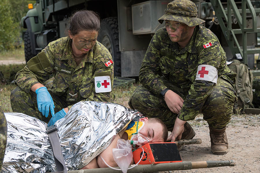 Canadian Army Reserve medics conduct casualty response training in August 2017 as part of Exercise STRIDENT TRACER 17 at 5th Canadian Division Support Base Gagetown in New Brunswick. Photo: Corporal Peter Ford, Combat Training Centre. ©2017 DND/-MDN Canada.