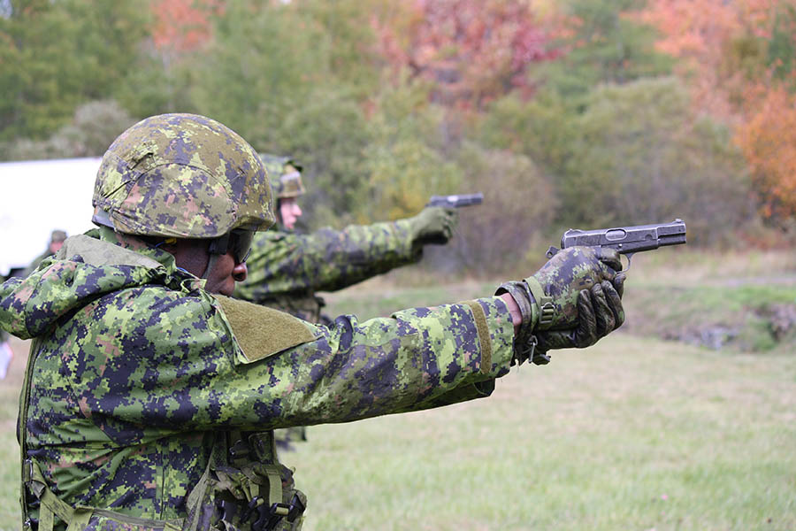 Captain Felix Odartey-Wellington fires a 9 mm pistol at the Sydney Range on October 12, 2014. 