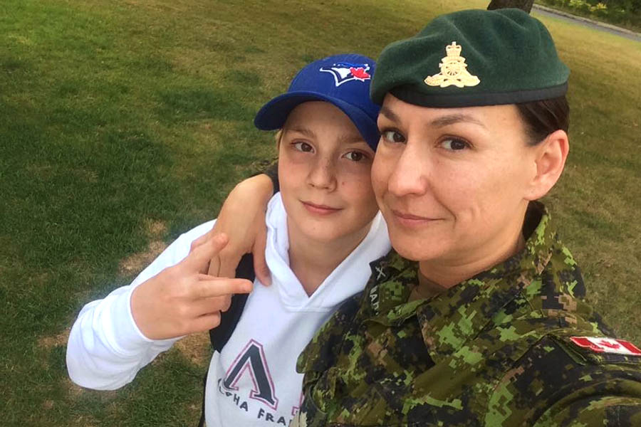 "Sergeant Marie-Eve Martin with son Alex on the first day of school on September 5, 2017 in Oromocto, New Brunswick. ""Our chain of command always give us the time to bring our kids to the first day of school and then report to work.""
