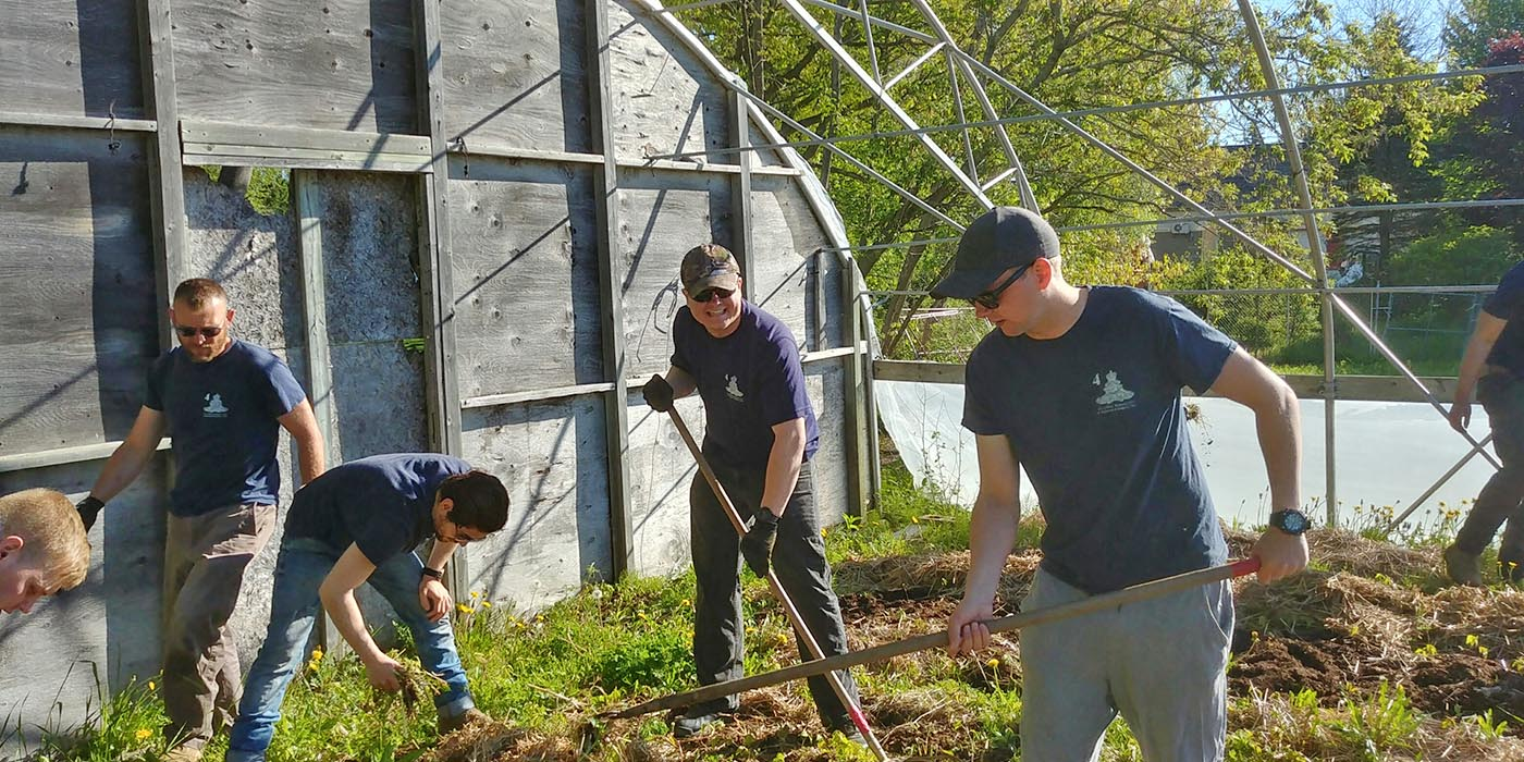 On June 6, 2019, members of 128 Battery, 4th Regiment, General Support, pitch in once again to open the gardens for Greener Village, a Fredericton, New Brunswick-based organization that provides food relief to local families. They are (left to right) Gunner Chris West, Gunner Royner Oviedo Espinoza, Gunner Sergey Novikov, and Gunner Padraic Delaney. Photo: Gunner Gerard Hazlehurst, 4th Regiment (General Support). ©2019 DND/MDN Canada.