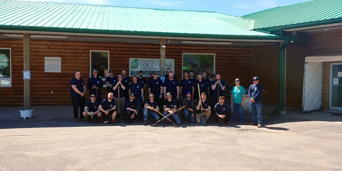 Members of 128 Battery, 4th Regiment (General Support) gather just before heading to Greener Village's gardens to help prepare them for the growing season. Greener Village, a Fredericton, New Brunswick charity organization, grows some of the food they distribute to needy families in the area. Alison Juta, Executive Assistant of Greener Village, stands second from the right. Photo: Gunner Gerard Hazlehurst, 4th Regiment (General Support). ©2019 DND/MDN Canada.