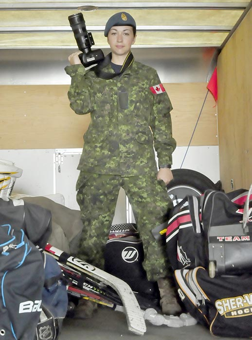 Aviator (Basic) Jade Lefebvre stands among an assortment of hockey gear