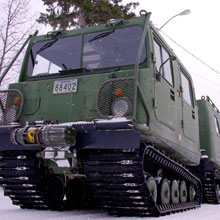 The cars of the BV 206 Tracked Carrier are coupled together by a central steering assembly.